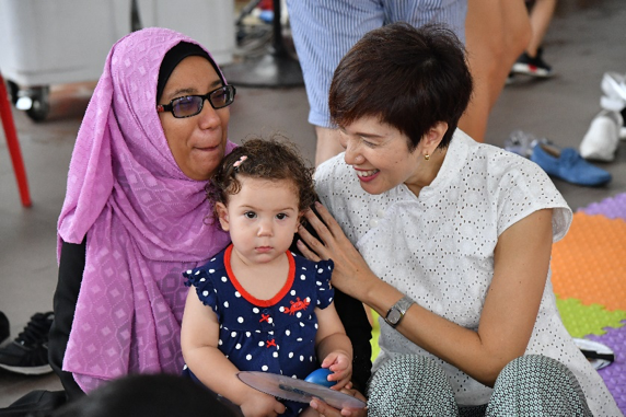 Minister Josephine Teo interacting with families during the mass parent-child activity.