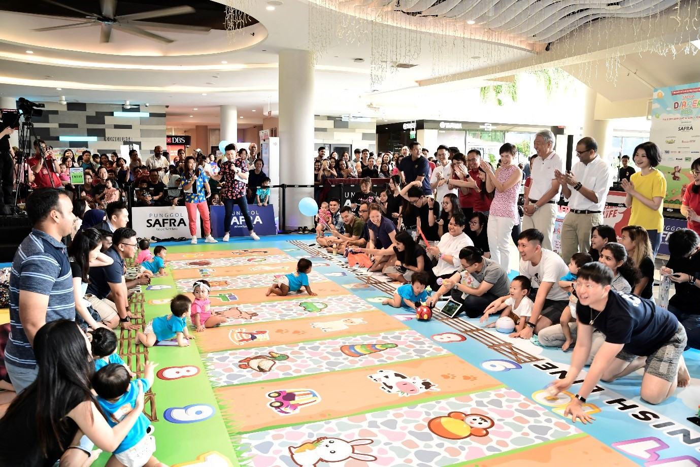 Babies in action during the SAFRA Diaper Dash.
