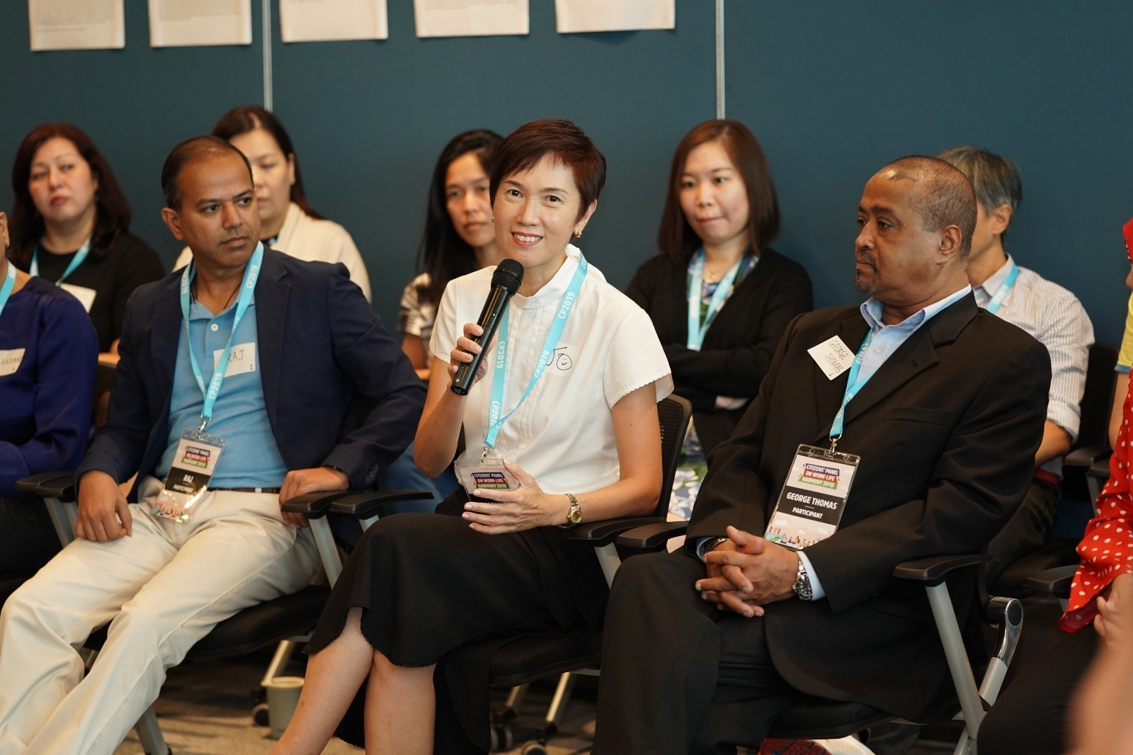 Minister Josephine Teo sharing her views with the Panel members during the conversation circle
