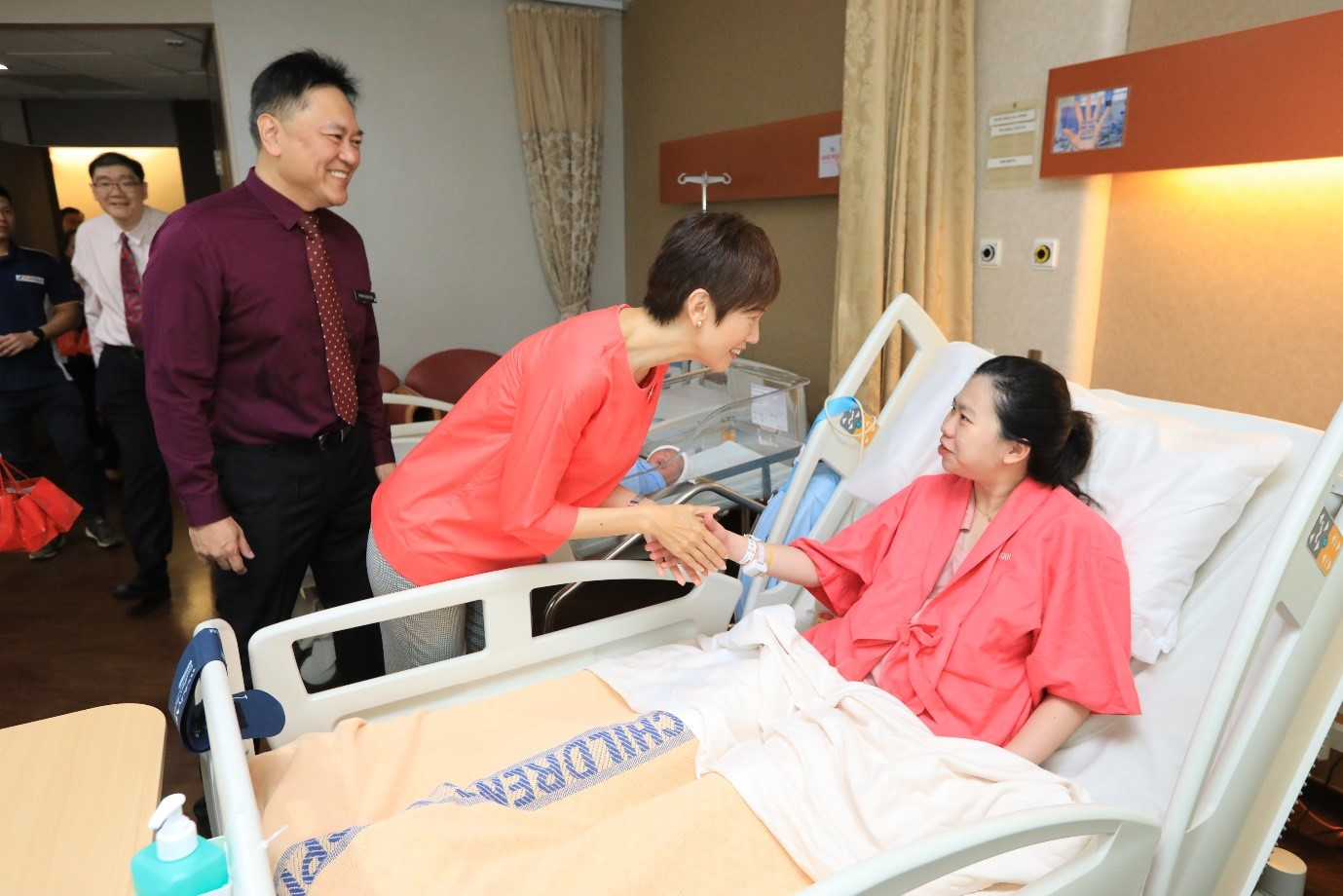 Minister Josephine Teo and Professor Alex Sia (Chief Executive Officer, KKH Women's and Children's Hospital) visiting Mdm Carina Seow who delivered her second child on 5 February, early Tuesday morning.