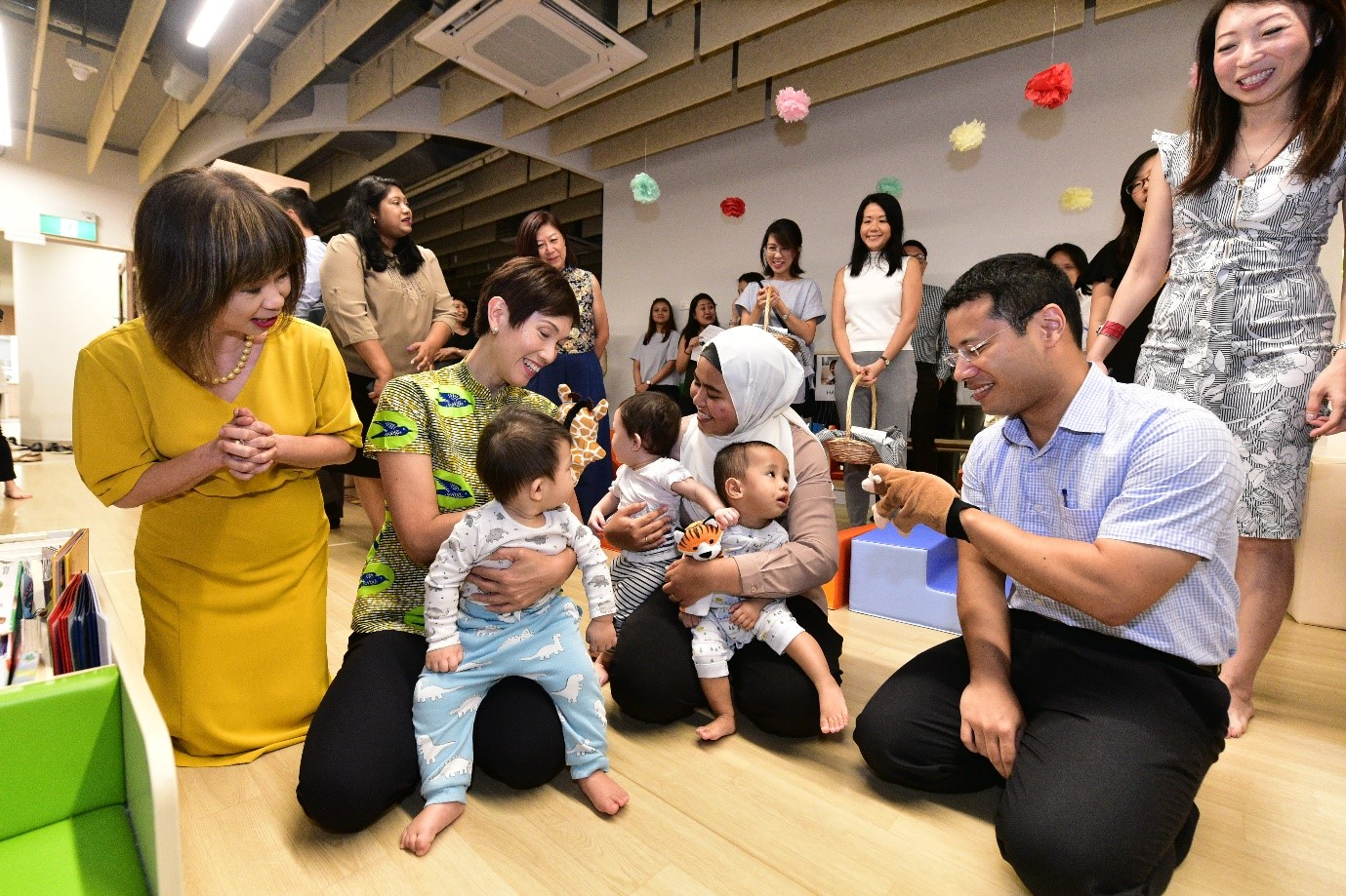 Minister Teo, Minister Lee and SMS Dr Amy Khor playing with the children at My First Skool's infant care.