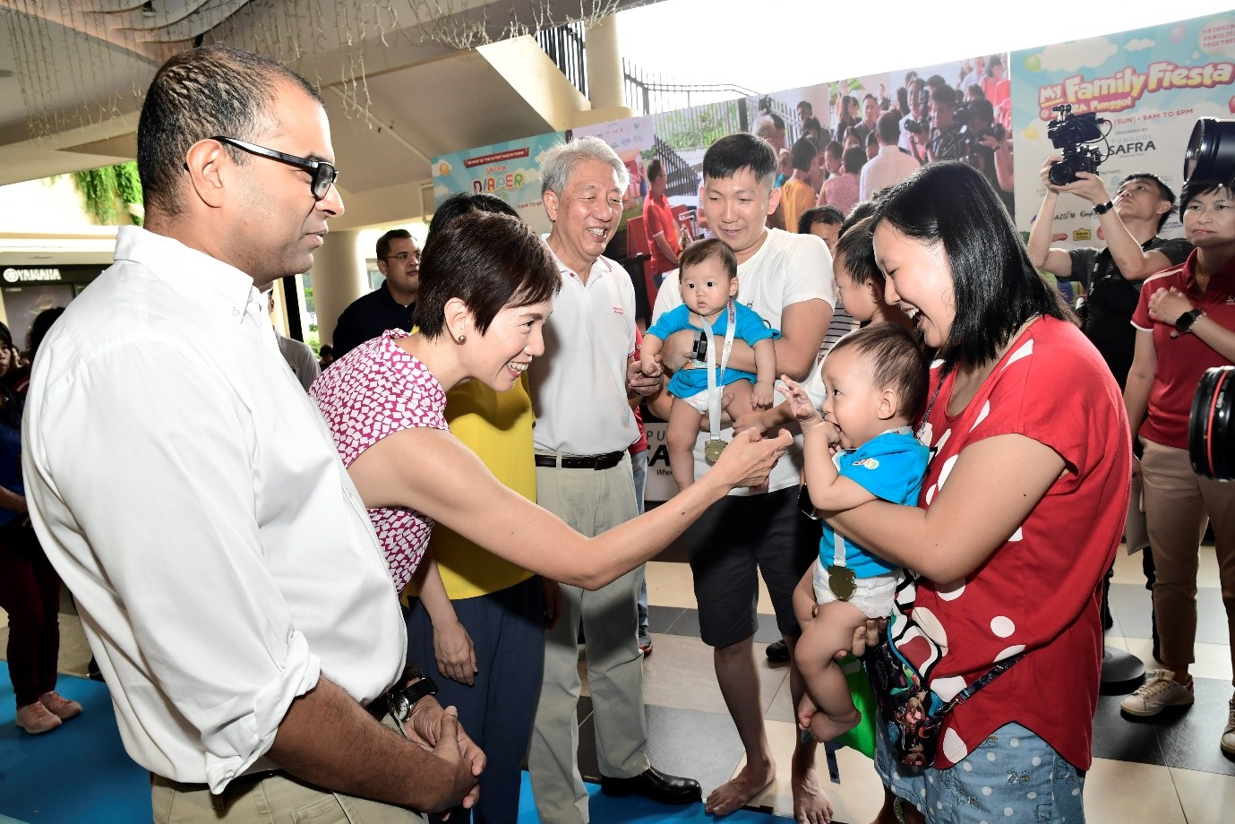 SM Teo, Minister Teo, and SMS Dr Janil spending time with families at My Family Fiesta.